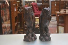 A pair of resin owl figures (h.39cm and 37cm)