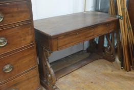 A 19th century library table, the rectangular top over two frieze drawers, raised on acanthus carved