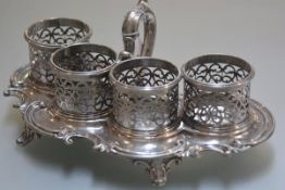 A 19th EPNS scalloped tray with holders and scroll handles. 12cm by 28cm