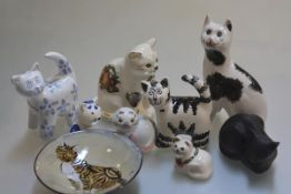 A Griselda Hill Wemyss style miniature cat (h.17cm), miscellaneous china cats, a bisque cat and dish
