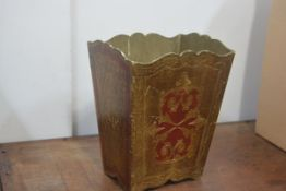 An Italian gilt plywood waste paper basket, with scalloped rim. 31cm by 25cm by 19cm