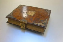 A Victorian walnut and brass mounted photograph album with leather spine, with closure fastening (