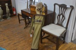 A 1920s/30s vintage golf bag in canvas with leather trim, complete with metal shafted clubs and