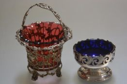 An EPNS Bristol blue glass lined pierced bon bon dish and an EPNS bon bon basket with cranberry