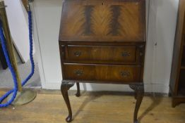A mahogany bureau, with rectangular top above a fall front, over two long drawers, on moulded