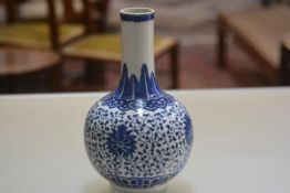 A modern Chinese blue and white vase. 29cm