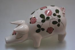A Plichta Pottery pig hatpin holder decorated with clover design (h.12cm l.22cm w.10cm)