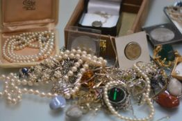 A collection of miscellaneous costume jewellery including paste, pebble jewellery, coins,