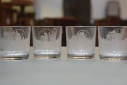 A set of four Edinburgh Crystal whisky tumblers with engraved castles including Glamis, Balmoral,