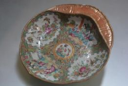 A 19th century Chinese lotus leaf shaped scalloped porcelain dish, decorated with famille rose style