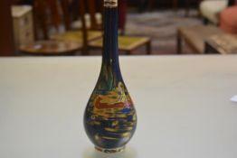 A Royal Cauldon Blue Lagoon pattern slim neck baluster vase decorated with seated figure in a canoe,