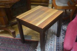 A walnut square topped occasional table, on square supports. 50cm by 46cm