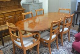 A yew wood reproduction seven pieced dining suite, comp. oval dining table, four plus two Regency