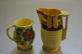 A 1930s Burleighware pottery ribbed jug decorated in the style of Clarice Cliff and a Susie Cooper