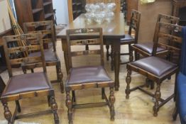 A set of six 1920's oak Jacobean ladder back dining chairs with inset seats. 87cm high