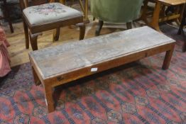 An Edwardian oak fender stool, with inset rectangular panelled seat on square supports. 30cm by