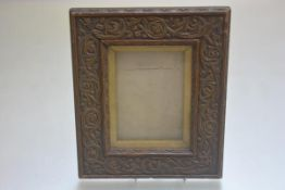 A rectangular Arts & Crafts style composition frame in scrollwork design (26cm x 21cm)