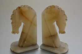 A pair of Art Deco onyx horse head bookends. 18cm