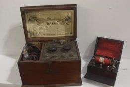 A mahogany case containing Revophone crystal set, complete with headset, instructions etc, and a