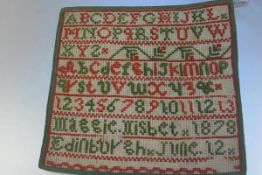 A Victorian sewn work sampler by Maggie Nisbet, 1878, Edinburgh, June 12th, on cotton backing with
