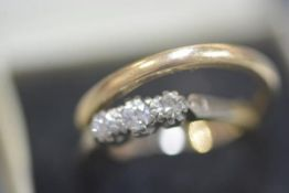 An 18ct yellow gold three stone illusion set diamond ring and a 9ct gold wedding band (2) 1.74 grams