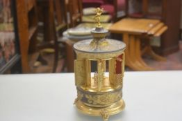 An American novelty musical 1960s cast metal and brass mounted table cigarette dispenser in the
