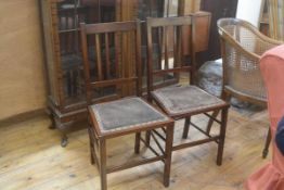 A pair of Edwardian mahogany spar back bedroom chairs, with velvet seats. 89cm