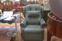 A Relaxor massage system electrically operated reclining easy chair in sage green leather with