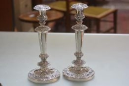 A pair of 19thc Sheffield plated candlesticks with C scroll and acanthus leaf chased decoration to