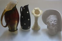 An Empire ware black and white decorated half jug, a Beleek posy, a Crown Devon red ribbed lustre