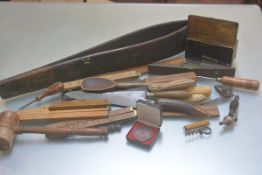 A collection of kitchenalia including bread knives, carving knives, wooden spoon, North British