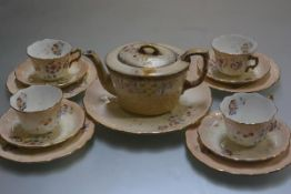 A Chelsea Royal pottery teapot (a/f) and similar decorated Limoges thirteen piece part teaset with