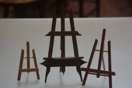 A group of three treen easels including a Bavarian style example. (3)