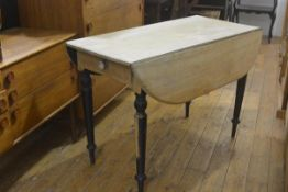 A Victorian partially stripped kitchen Pembroke table, of characteristic form, over frieze drawer,