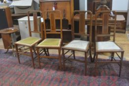 A set of four Edwardian mahogany inlaid panel back bedroom chairs with inset seats on turned tapered