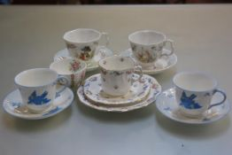 A pair of Royal Albert World of Beatrix Potter cups and saucers, a pair of HM Williamsons