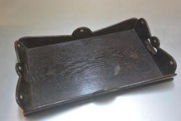 A John O Groats tea tray, D.L.Baikie Cabinetmaker, Lochshell, Wick, Scotland, an oak cowrie shell
