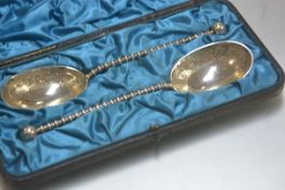 A pair of Edwardian Epns serving spoons with oval bowls and ball pattern terminals, in original