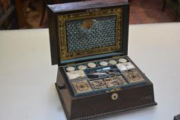 A Regency rosewood sarcophagus sewing box with engraved mother of pearl plaque Elizabeth