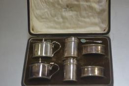 A Mappin & Webb six piece table condiment set comprising two salt cellars, two pepperettes and two