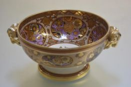 A Noritake fruit bowl decorated with exotic rose design with amethyst oval panels outlined in