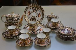A Royal Crown Derby thirty four piece coffee set including sucrier, cream jug, teapot (a/f), cake