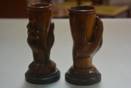 Two treen carved late 19thc Hands of Plenty on circular hardwood base (h.22cm)