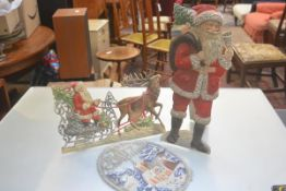 A group of three 1920s/30s embossed paper handpainted Christmas decorations including standing