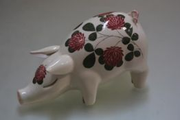A Plichta Pottery pig decorated with clover design (h.12cm l.23cm)