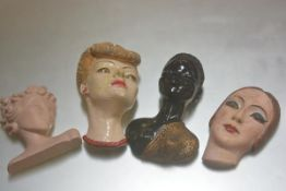 A collection of four various mid 20thc plaster moulded and decorated masks (tallest: 28cm)