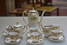 A Meito handpainted Noritake style fifteen piece coffee set complete with coffee pot, two handled