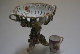 A Continental china two handled floral encrusted comport, raised on tripod support and a Dresden