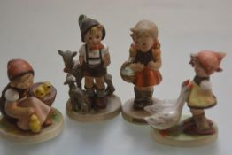 A collection of four Hummel figures including, Schoolgirl, Goosegirl and Little Goatherd, all