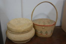 A raffia basket and a pine tree decorated loop handled basket (2) 22cm and 19cm